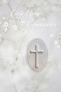 First communion holy greeting card with white prayer book cross and babys breath flowers as a symbol of purity Royalty Free Stock Photos