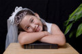 First communion a studio portrait of a young girl at isoltaed on black Royalty Free Stock Photo