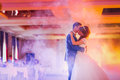 First dance the bride and groom in the smoke Royalty Free Stock Photo