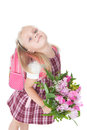 First day at school portrait of a happy schoolgirl with pink backpack and flowers over white Royalty Free Stock Images