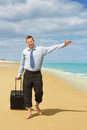 First day of vacation businessman walking on the beach the Royalty Free Stock Photos