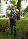 First grader boy a for the time goes to school behind his back pack in the hands of a package of sweets this is berlin Stock Photography