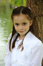 First holy communion portrait of a girl in a white dress on the day of Royalty Free Stock Image