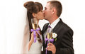 First kiss and champagne married couple kissing holding glasses of Royalty Free Stock Photos