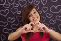First love woman showing heart shape with her hands Royalty Free Stock Photo