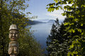 First nation totem pole with lake in the background vancouver island canada Royalty Free Stock Image