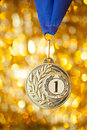 First place golden medal on shiny background Stock Photos