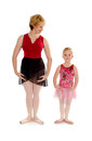 First position ballet dance student lesson a primary in a school class with her teacher learns Stock Photo