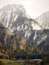 First snow in landquart mountains in switzerland comes lanquart with the last saturated colors of autumn on the trees Royalty Free Stock Photos