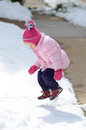 First snow a two year old girl plays in the snowfall of the season Royalty Free Stock Photography