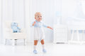 First steps of baby boy learning to walk Royalty Free Stock Photo