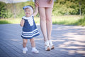 First steps on a cute baby girl in summer Stock Photography