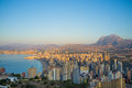 First sunrays on benidorm the early morning sun starting to light skyline costa blanca spain Stock Image