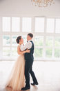 First wedding danc.wedding couple dances on the studio. Wedding day. Happy young bride and groom on their wedding day. Royalty Free Stock Photo