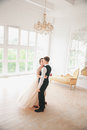 First wedding dance.wedding couple dances on the studio Wedding day. Happy young bride and groom on their wedding day. Royalty Free Stock Photo