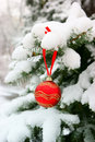 Firtree with christmas ball and snow Royalty Free Stock Images