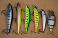 Fish baits set on wooden Royalty Free Stock Photo