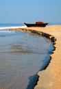Fish boat on the shore of arabian sea in goa india Stock Image