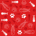 Fish bones and cats paws on red background seamless vector with cat s Royalty Free Stock Photos