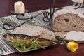 Fish and bread beautiful table setting with pescetarian diet of smoked sliced sourdough basil on plate next to yellow rose Royalty Free Stock Photography