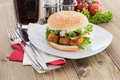 Fish burger with cold drink on wood Royalty Free Stock Photo