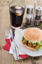 Fish burger with cold drink on wood Stock Photo