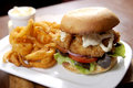Fish burger on white plate Royalty Free Stock Photo