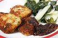 Fish cakes with onion marmalade homemade fishcakes and serves boiled greens Royalty Free Stock Photos