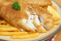 Fish and chips battered cod with fries on plate Stock Image