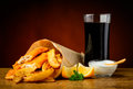 Fish chips and cola drink still life with dip sauce lemons Stock Images