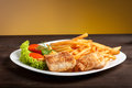 Fish and chips with lettuce tomato Stock Images