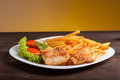 Fish and chips with lettuce tomato Stock Photos