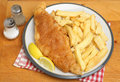 Fish and chips meal battered cod on plate Stock Photography