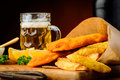Fish and chips meal and beer still life with glass of Stock Images