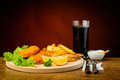 Fish and chips menu with cola drink still life traditional Stock Image