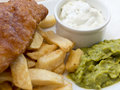 Fish chips and tartare sauce battered french fries mushy peas Royalty Free Stock Image