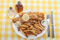 Fish and chips a traditional plate of on a yellow checkered tablecloth Stock Photos