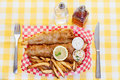 Fish and chips a traditional serving of Royalty Free Stock Photo