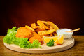 Fish and chips on a wooden plate still life with lemon dip sauce Royalty Free Stock Photos