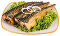 Fish cooking smoked in the plate Royalty Free Stock Images