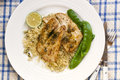 Fish with Cous Cous and Snow Peas Stock Photography