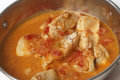 Fish curry in a kadai closeup basic spicy tomato and coconut milk sauce karahi or wok serving bowl close up Stock Photos