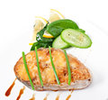 Fish dish - fried fish fillet with vegetables Royalty Free Stock Photo