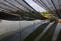 Fish farm net in pond Stock Photos