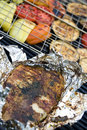 Fish file and vegetables barbecue Stock Images
