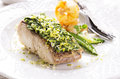 Fish filet fired with herbs as closeup on a white plate Royalty Free Stock Photography