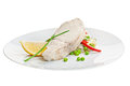 Fish fillet with lemon and garnish Stock Images