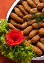 Fish fingers dish a plate of elegant called with tomato and lettuce decoration Royalty Free Stock Photo