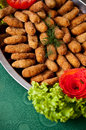 Fish fingers dish a plate of elegant called with tomato and lettuce decoration Stock Photos