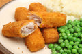 Fish fingers or sticks dinner with mashed potato and peas Stock Photo